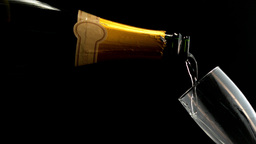 Champagne being poured from the bottle to the flut Stock Video Footage
