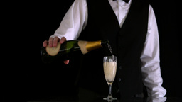 Waiter filling champagne flute Stock Video Footage