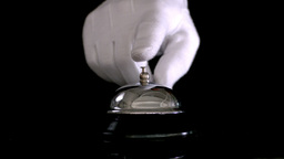 Hand ringing hotel bell Footage