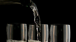 Three champagne flutes being filled Footage