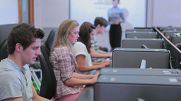Teacher Standing At The Computer Room stock footage