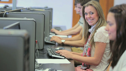 Student sitting at the computer and smiling Stock Video Footage