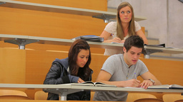 Students sitting at desks in lecture hall Stock Video Footage
