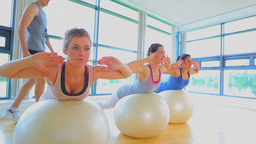 Video of women balancing on exercise balls with tr Stock Video Footage
