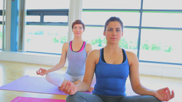Smiling Women Sitting On Yoga Mats stock footage