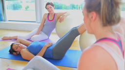 Three women talking during the break from yoga cla Stock Video Footage
