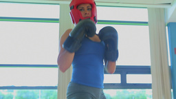 Video of focused woman kickboxing Footage