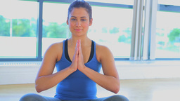 Video of a woman sitting in yoga pose Stock Video Footage