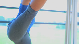 Video of a woman doing extended hand to toe pose Footage