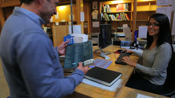 Man taking out a book Stock Video Footage
