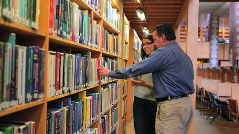 Woman and man finding a book Footage