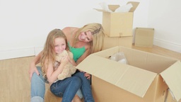 Video of mother and daughter unpacking Stock Video Footage