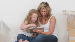 Video of happy mother and daughter using tablet co Stock Video Footage