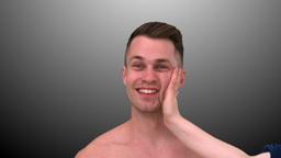 Smiling man taking a slap Footage
