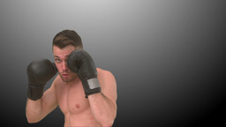 Focused man boxing in the air Footage