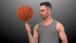 Man spinning the ball on his finger Stock Video Footage