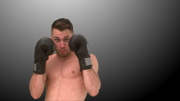 Focused man practicing boxing on black background Stock Video Footage