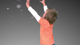 Little boy playing with bubbles Footage