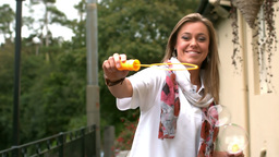 Video of woman making bubbles Stock Video Footage