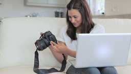 Video of woman viewing photos in photo camera Stock Video Footage