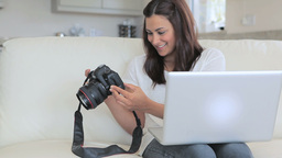 Video of woman viewing photos in photo camera Footage