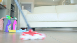 Woman mopping the floor Footage