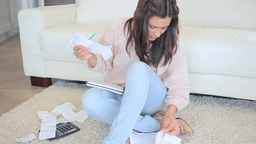 Woman using calculator Stock Video Footage