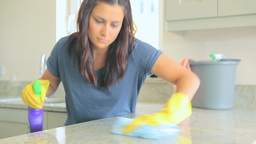 Woman cleaning worktop Stock Video Footage