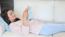 Video of woman reading a book Stock Video Footage