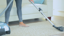 Video of woman hoovering rug Live Action