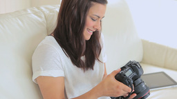 Video of woman holding a camera Stock Video Footage