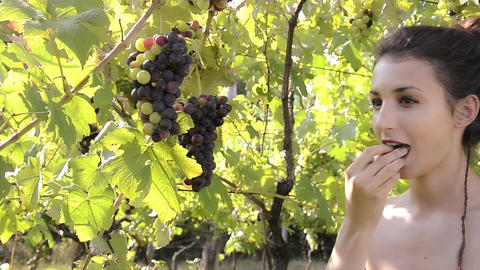 a girl with a bunch of grapes Footage