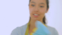 Smiling woman with cloth and spray bottle Footage