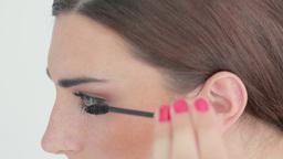 Woman applying mascara Footage