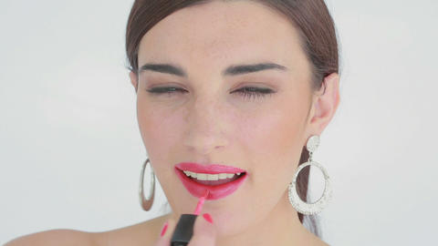 Woman applying pink lip gloss Stock Video Footage