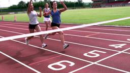 Athletes running towards finish line Footage