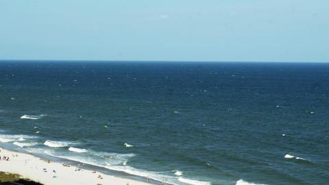1851 People Enjoying the Beach with Ocean Waves, H Footage