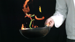 Flaming wok being tossed Footage