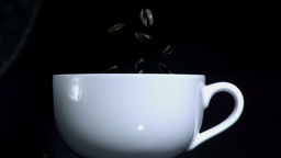 Coffee beans falling into cup Stock Video Footage