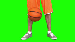 Man playing basketball on green background Footage