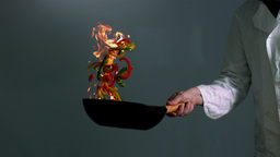 Chef tossing flaming stir fry ビデオ