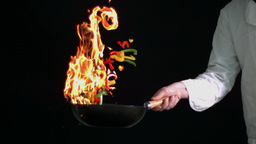 Chef flambeing peppers in wok Footage