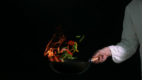 Peppers burning in a pan with little flame Footage