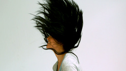 Woman shaking her hair upwards Footage