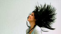 Woman shaking her hair upwards Stock Video Footage