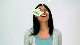 Woman looking at money falling Footage