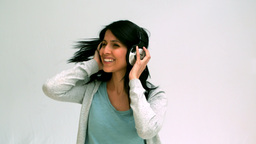 Woman listening and dancing with headphones Footage