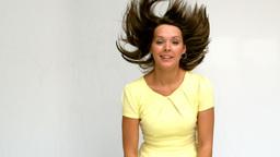 Brunette woman tossing hair Footage