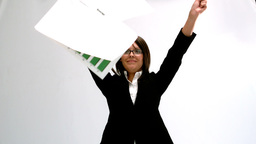 Businesswoman throwing papers Stock Video Footage