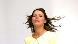 Woman turning with her hair in the wind Stock Video Footage